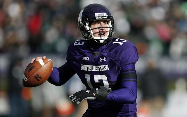 FILE - In this Nov. 23, 2013 file photo, Northwestern quarterback Trevor Siemian (13) sets up for a pass against Michigan State during the first half of an NCAA college football game in Evanston, Ill. Siemian says it was wrong for former quarterback Kain Colter and other players to explore unionization without first taking their concerns to their coach and administrators. (AP Photo/Andrew A. Nelles, File)