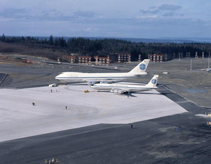 A Boeing 747 next to a smaller Boeing 707.
