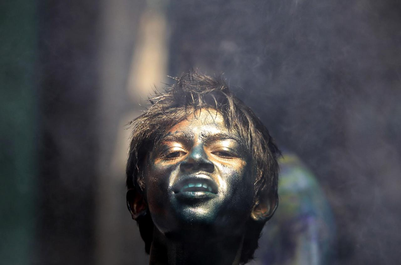 AP10ThingsToSee - A Bangladeshi Hindu child with his face smeared in colors participates in Holi festival celebrations in Dhaka, Bangladesh, Thursday, March 28, 2013. (AP Photo/A.M. Ahad, File)