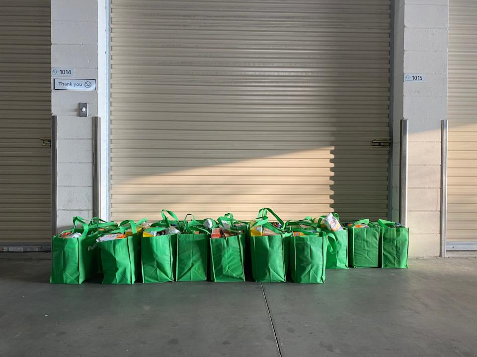Bags of groceries packed by volunteers to hand out to furloughed and laid-off Disney employees.Richard Hall / The Independent