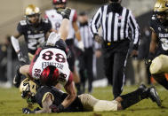 San Diego State tight end Daniel Bellinger, top, is upended by Colorado safety Derrion Rakestraw in the second half of an NCAA college football game Saturday, Nov. 28, 2020, in Boulder, Colo. (AP Photo/David Zalubowski)