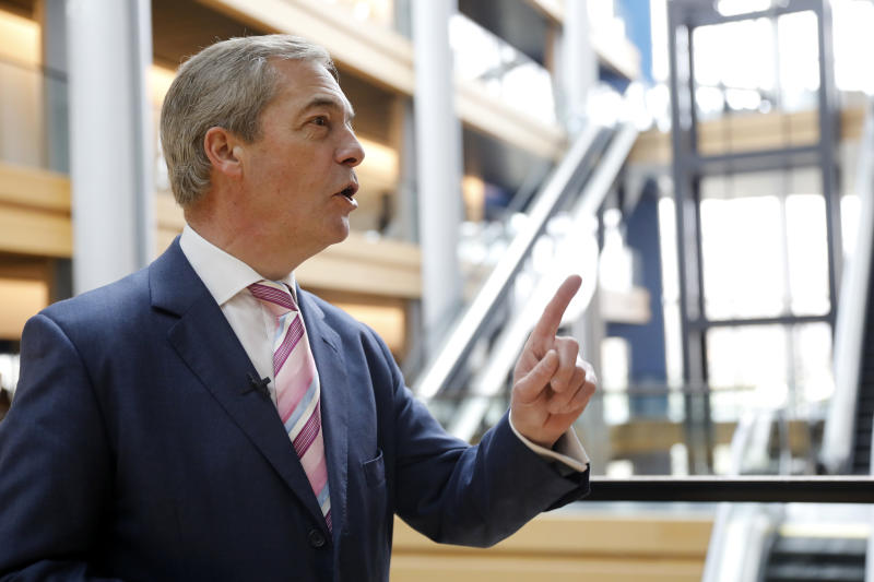 Nigel Farage, the leader of the Brexit Party, answers reporters at the European parliament Tuesday, Jan.14, 2020 in Strasbourg, eastern France. (AP Photo/Jean-Francois Badias)
