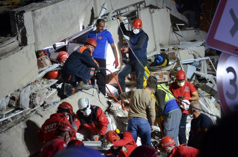 Rescuers searched for survivors with their bare hands