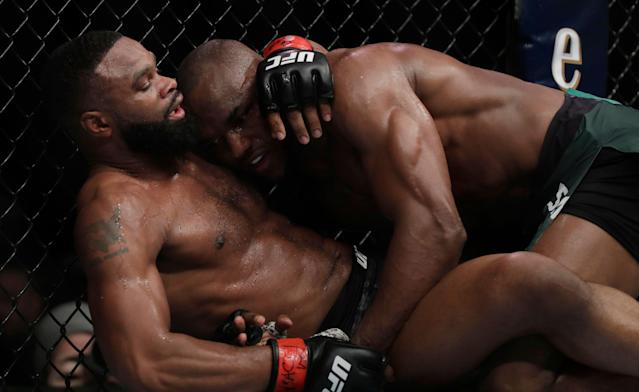 Tyron Woodley (L) and Kamaru Usman grapple during their welterweight title bout on Saturday in Las Vegas. (Getty Images)