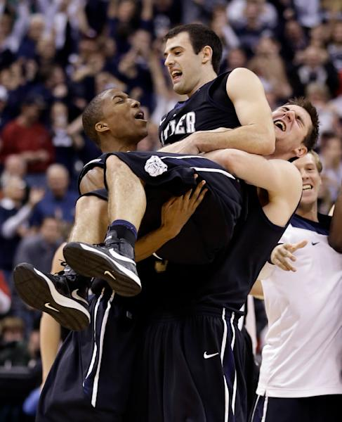 Butler guard Alex Barlow, center, is carried by forward Kameron Woods, left, and center Andrew Smith after Butler defeated No. 1 Indiana 88-86 in overtime in an NCAA college basketball game in Indianapolis, Saturday, Dec. 15, 2012. Barlow hit the game-winning shot. (AP Photo/Michael Conroy)