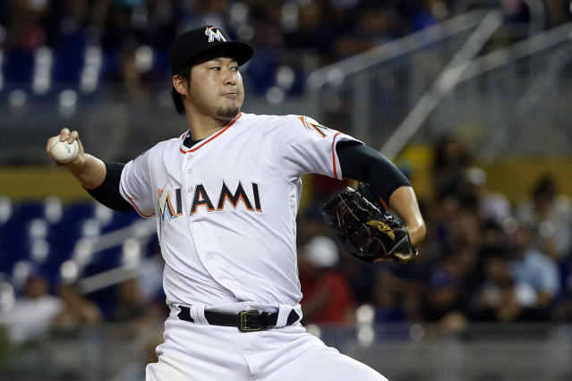 Miami Marlins' Junichi Tazawa, of Japan, delivers a pitch during the fourth inning of a baseball game against the Los Angeles Dodgers, Thursday, May 17, 2018, in Miami. (AP Photo/Wilfredo Lee)