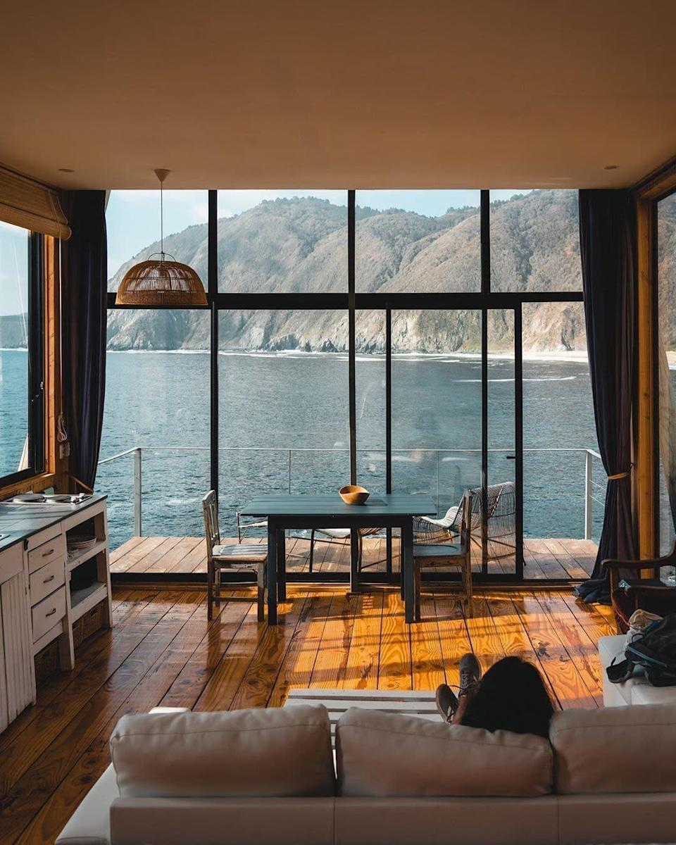 """<p>The view from this coastal cabin in the Valparaiso region of Chile is truly captivating. Taking the second spot, this <a href=""""https://www.housebeautiful.com/uk/lifestyle/property/"""" rel=""""nofollow noopener"""" target=""""_blank"""" data-ylk=""""slk:property"""" class=""""link rapid-noclick-resp"""">property</a> is a modern loft surrounded by rocks and gardens.</p><p><a class=""""link rapid-noclick-resp"""" href=""""https://go.redirectingat.com?id=127X1599956&url=https%3A%2F%2Fwww.airbnb.co.uk%2Frooms%2F29459696&sref=https%3A%2F%2Fwww.housebeautiful.com%2Fuk%2Flifestyle%2Fproperty%2Fg35381593%2Fairbnb-most-liked-homes%2F"""" rel=""""nofollow noopener"""" target=""""_blank"""" data-ylk=""""slk:MORE INFO"""">MORE INFO</a></p>"""