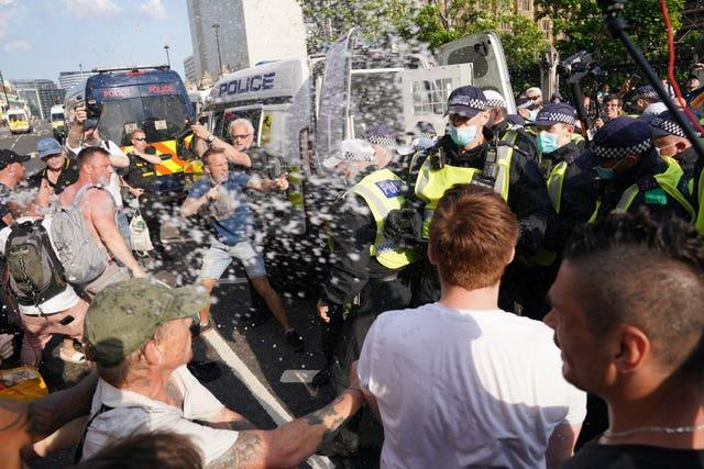 Police and protesters face each other in Parliament Square