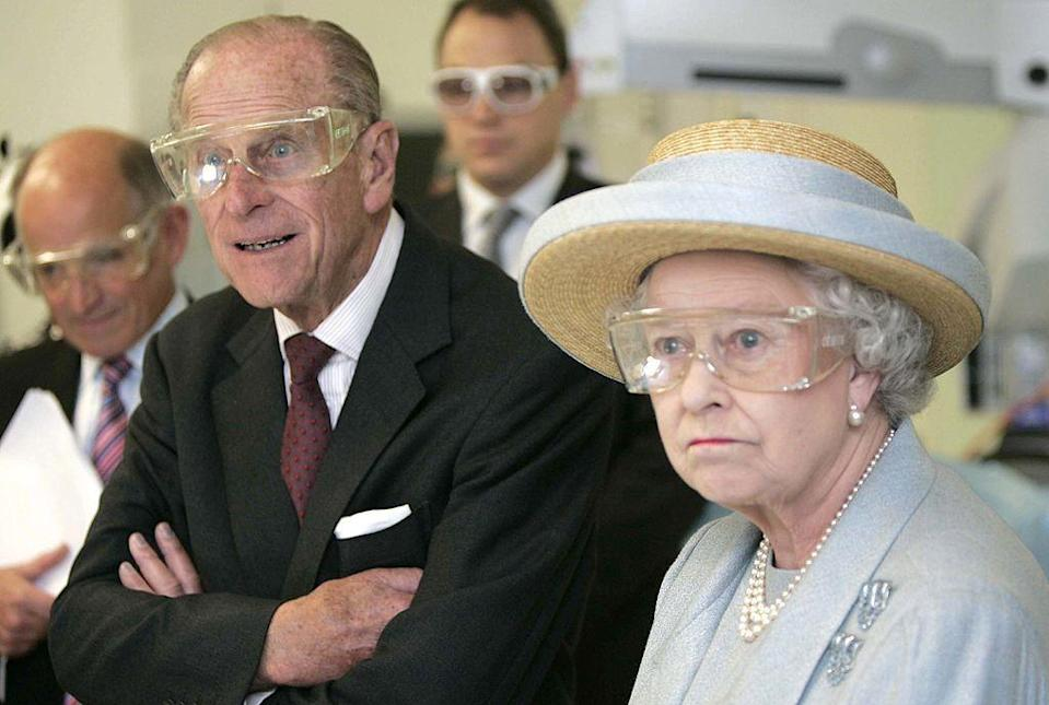 <p>Wearing protective eyewear during a visit of University College Hospital, London.</p>
