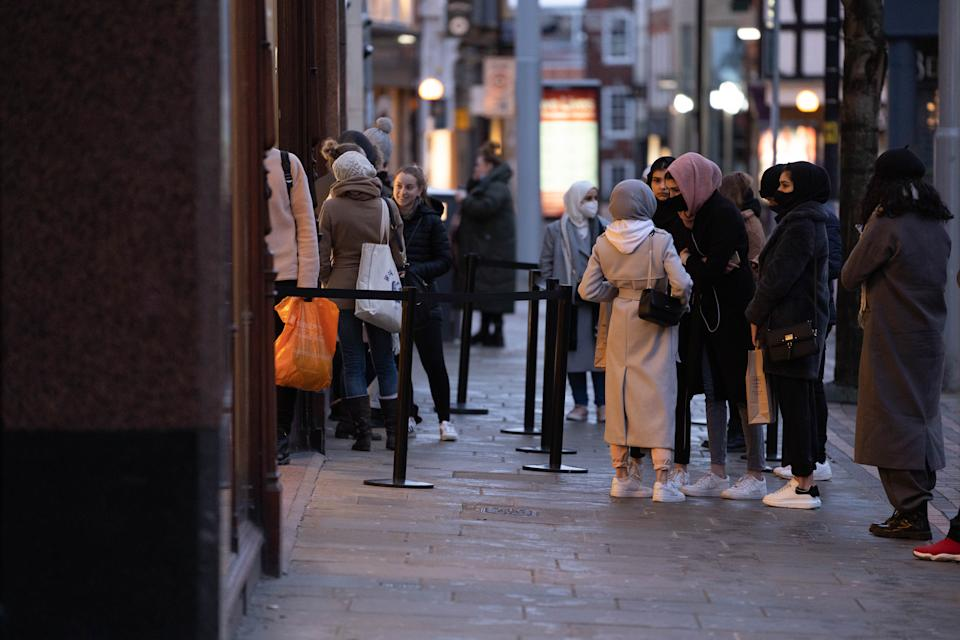 Shoppers wait outside Zara store in Nottingham (swns)