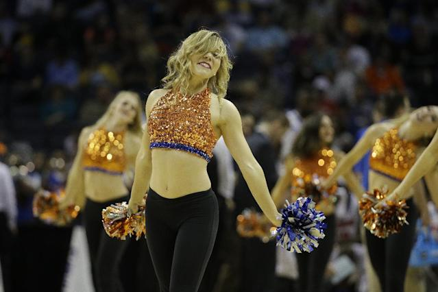 Florida cheerleaders perform during the first half in a regional semifinal game against UCLA at the NCAA college basketball tournament, Thursday, March 27, 2014, in Memphis, Tenn. (AP Photo/Mark Humphrey)