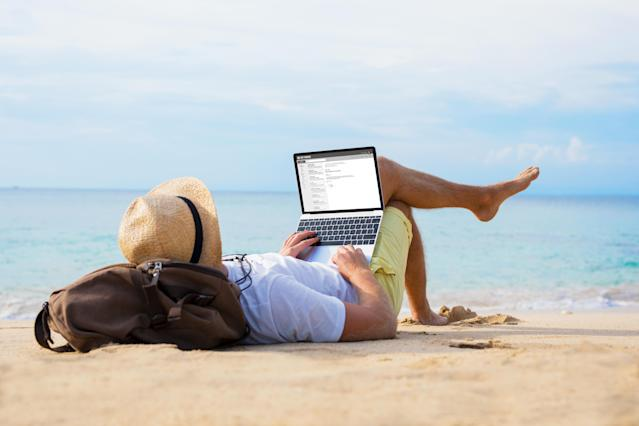 Many people continue to work even while on a holiday. (Getty)