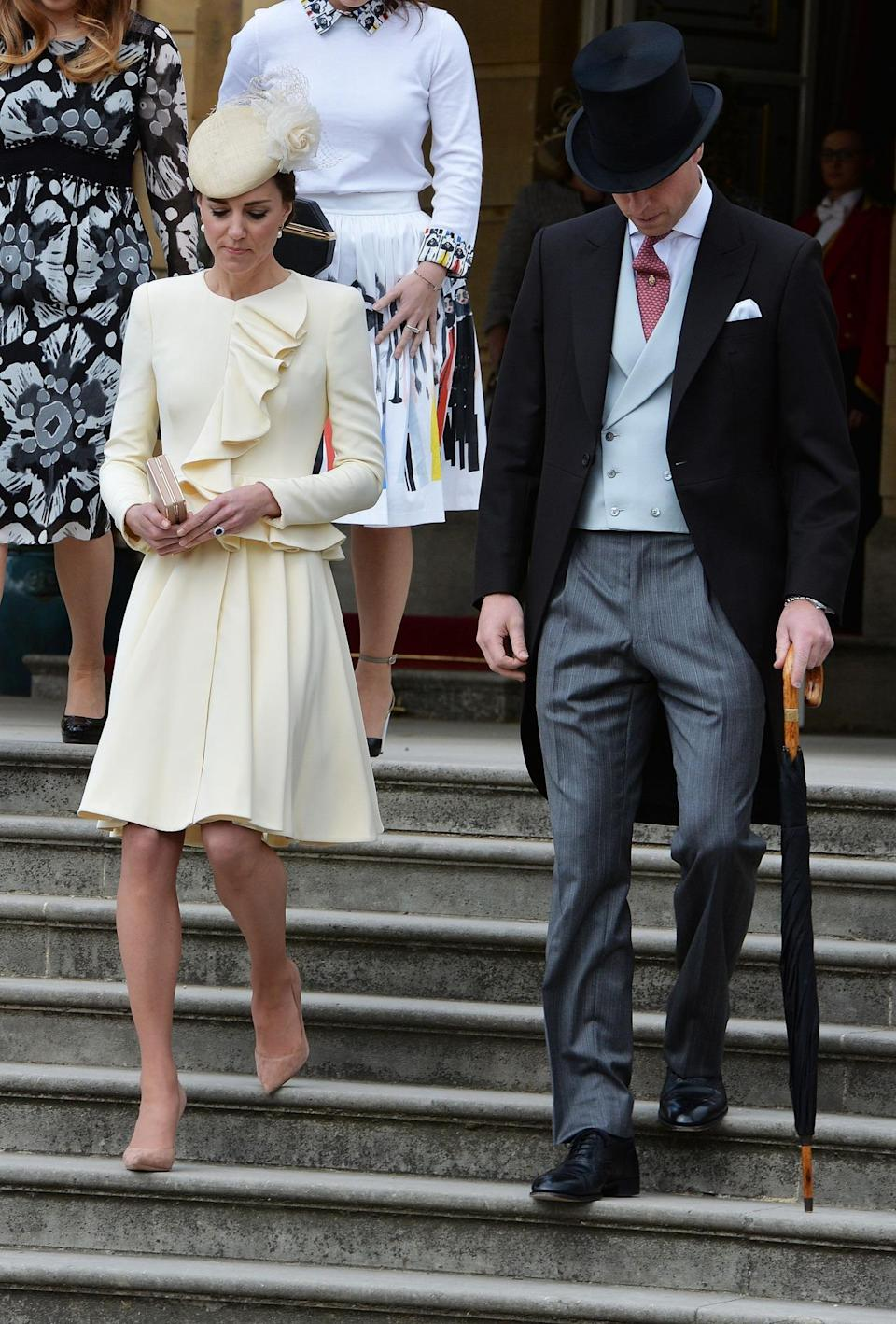 <p>Who wouldn't dream of bespoke Alexander McQueen? Kate lived every woman's fantasy at Buckingham Palace's garden party in a subtle yellow ruffled look taken from the label's SS12 collection.</p><p><i>[Photo: PA]</i></p>