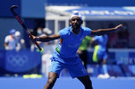 India's Mandeep Singh (11) defends against Germany during the men's field hockey bronze medal match at the 2020 Summer Olympics, Thursday, Aug. 5, 2021, in Tokyo, Japan. (AP Photo/John Minchillo)