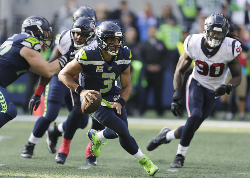 Seattle Seahawks quarterback Russell Wilson threw for 452 yards in an amazing win over the Houston Texans. (AP)