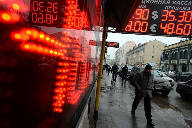 """For the first time it took more than 53 rubles to buy one euro Friday, and the rate against the dollar topped 41.92 with speculation swirling that Standard and Poor's could cut its rating for Russia to a """"speculative"""" level (AFP Photo/Vasily Maximov)"""