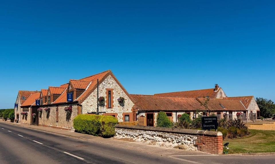 """<p>Another contemporary choice in pretty Titchwell, <a href=""""https://go.redirectingat.com?id=127X1599956&url=https%3A%2F%2Fwww.booking.com%2Fhotel%2Fgb%2Fbriarfields.en-gb.html%3Faid%3D2070929%26label%3Ddog-friendly-norfolk&sref=https%3A%2F%2Fwww.redonline.co.uk%2Ftravel%2Finspiration%2Fg34450137%2Fdog-friendly-hotels-norfolk%2F"""" rel=""""nofollow noopener"""" target=""""_blank"""" data-ylk=""""slk:Briarfields"""" class=""""link rapid-noclick-resp"""">Briarfields</a> offers 12 dog-friendly rooms in cool converted outbuildings. Hole up in the cosy snug for a warming après-walk drink, and enjoy palate-pleasing local produce in the relaxed bar with Fido.</p><p>This homely place to stay with your dog in Norfolk affords a terrific location, with views of Titchwell RSPB salt marshes, which are home to both freshwater and saltwater wildlife.</p><p><a class=""""link rapid-noclick-resp"""" href=""""https://go.redirectingat.com?id=127X1599956&url=https%3A%2F%2Fwww.booking.com%2Fhotel%2Fgb%2Fbriarfields.en-gb.html%3Faid%3D2070929%26label%3Ddog-friendly-norfolk&sref=https%3A%2F%2Fwww.redonline.co.uk%2Ftravel%2Finspiration%2Fg34450137%2Fdog-friendly-hotels-norfolk%2F"""" rel=""""nofollow noopener"""" target=""""_blank"""" data-ylk=""""slk:CHECK AVAILABILITY"""">CHECK AVAILABILITY</a></p>"""