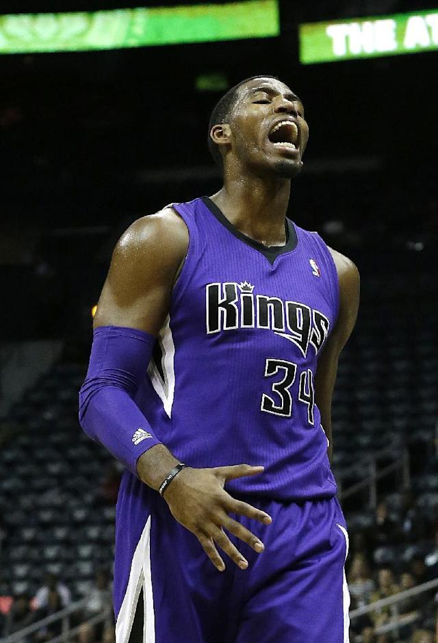 Sacramento Kings power forward Jason Thompson (34) yells after being called for a foul in the first half of an NBA basketball game against the Atlanta Hawks, Wednesday, Dec. 18, 2013, in Atlanta. (AP Photo/John Bazemore)