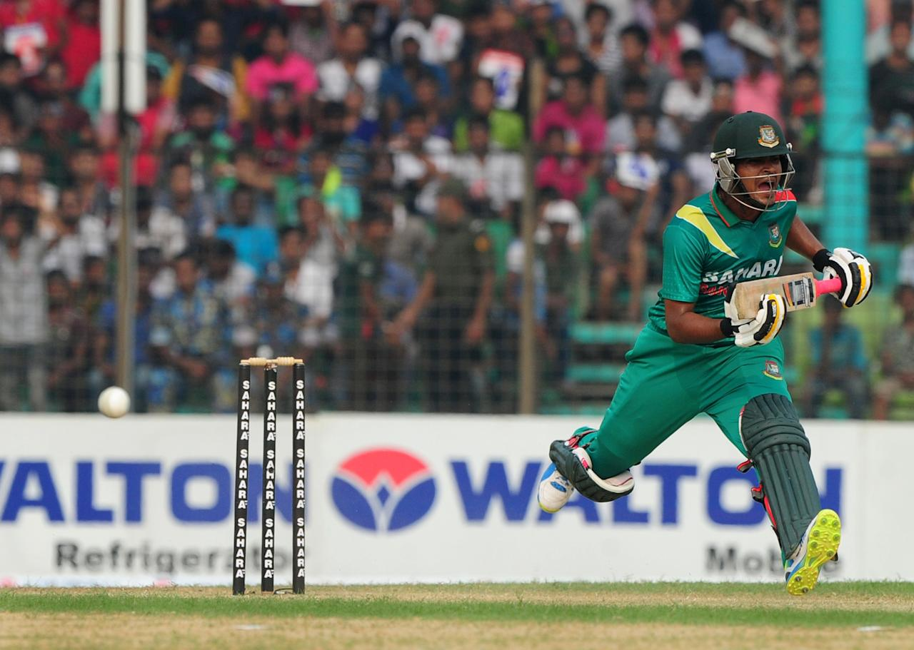 Bangladesh batsman Shamsur Rahman reacts after playing a shot during the third One-Day International (ODI) cricket match between Bangladesh and New Zealand at Khan Jahan Ali Stadium in Fatullah, on the outskirts of Dhaka on November 3, 2013.   AFP PHOTO/ Munir uz ZAMAN        (Photo credit should read MUNIR UZ ZAMAN/AFP/Getty Images)