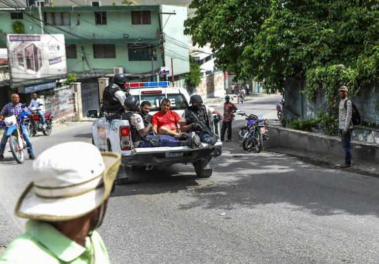 Two men, accused of being involved in Moise's assassination, are being transported to a police station in Port au Prince