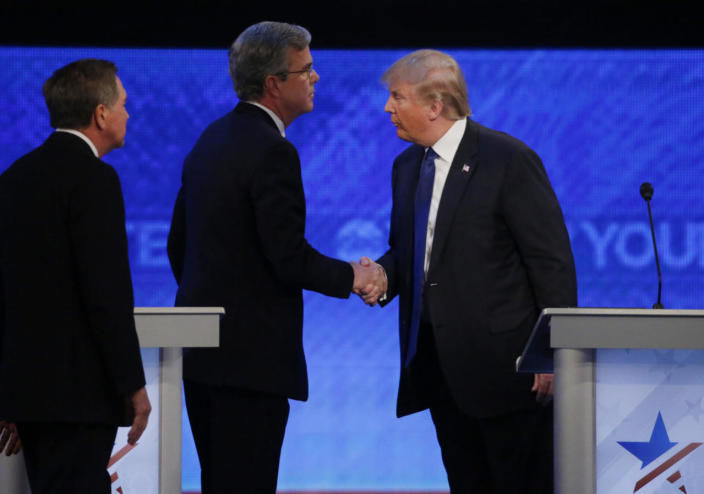 <p>Ohio Gov. John Kasich looks on as former Florida Gov. Jeb Bush shakes hands with businessman Donald Trump at the conclusion of the Republican presidential debate sponsored by ABC News at St. Anselm College in Manchester, N.H., on Feb. 6, 2016. <i>(Photo: Carlo Allegri/Reuters)</i></p>
