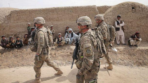 PHOTO: Soldiers with the U.S. Army's 4th squadron 2d Cavalry Regiment walk through a village during a joint patrol with soldiers from the Afghan National Army (ANA) on March 2, 2014, near Kandahar, Afghanistan. (Scott Olson/Getty Images, FILE)