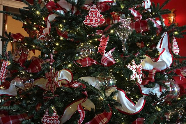 <p>Ornaments are hung on a Christmas tree in the Red Room at the White House during a press preview of the 2017 holiday decorations Nov. 27, 2017 in Washington, D.C. on Nov. 27, 2017. (Photo: Saul Loeb/AFP/Getty Images) </p>