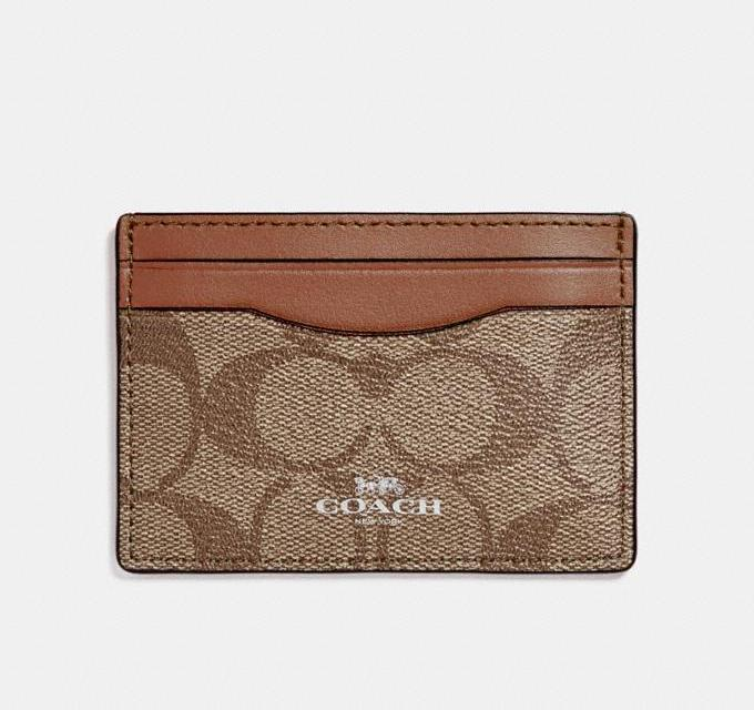 Card Case In Signature Canvas. Image via Coach OUtlet.