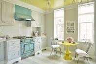 """<p>""""A pop of color is such a chic alternative to an all-white kitchen, but just as timeless,"""" proclaims <a href=""""https://bjminc.com/"""" rel=""""nofollow noopener"""" target=""""_blank"""" data-ylk=""""slk:Brian McCarthy"""" class=""""link rapid-noclick-resp"""">Brian McCarthy</a>, who paired a buttery yellow ceiling (a custom Donald Kaufman Color shade) and breakfast table (by Mongiardo Studio) with a robin's egg blue La Cornue range in a client's Manhattan apartment. """"Who says kitchens can't have as much personality as the rest of the house?""""</p>"""