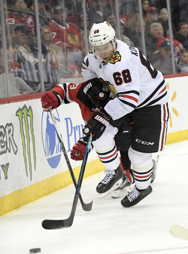 Chicago Blackhawks defenseman Slater Koekkoek (68) chases after the puck during the second period of an NHL hockey game against the New Jersey Devils,Friday, Dec. 6, 2019, in Newark, N.J. (AP Photo/Bill Kostroun)