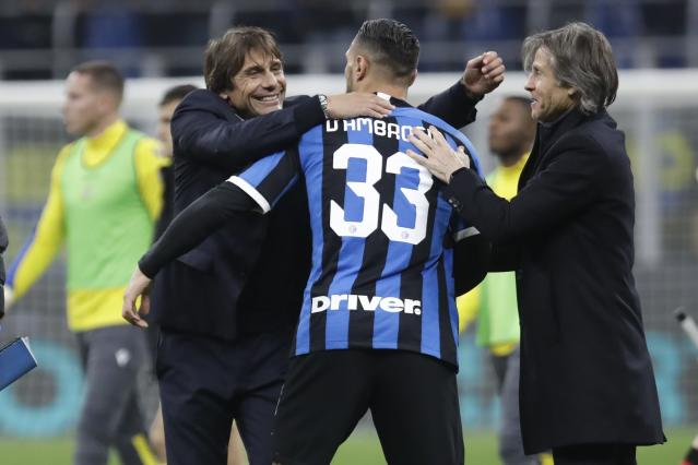 Inter Milan's head coach Antonio Conte, left, celebrates with Danilo D'Ambrosio, center, and team manager Gabriele Oriali at the end of the Serie A soccer match between Inter Milan and Hellas Verona, at the San Siro stadium in Milan, Italy, Saturday, Nov. 9, 2019. Inter won 2-1. (AP Photo/Luca Bruno)
