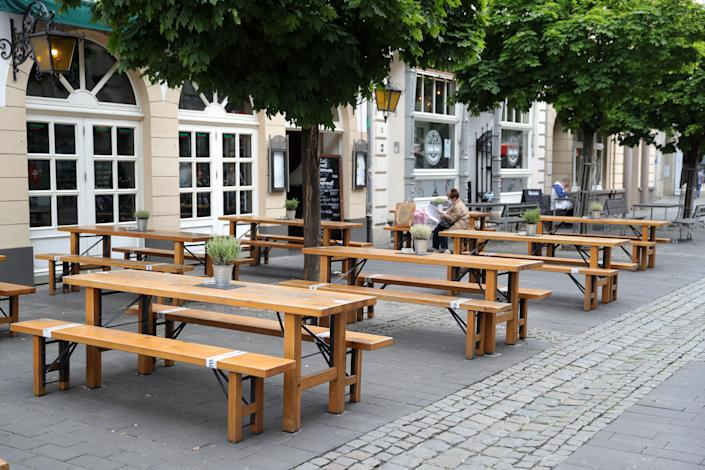 A customer sits outdoors a day after restaurants and cafes were allowed to reopen for the first time since March in Cologne, Germany. (Photo: Andreas Rentz via Getty Images)