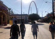 """Expelled migrants walking in Tijuana, Mexico, Oct. 8, 2020. President Donald Trump's reshaping of U.S. immigration policy may be most felt in his undoing of asylum. The suspension of asylum and the introduction of """"express deportations,"""" as migrants call them, have accelerated a shift in who's crossing the border illegally: more Mexican men who come for economic reasons and far fewer from Central America, Africa and elsewhere who seek asylum. (AP Photo/Elliot Spagat)"""