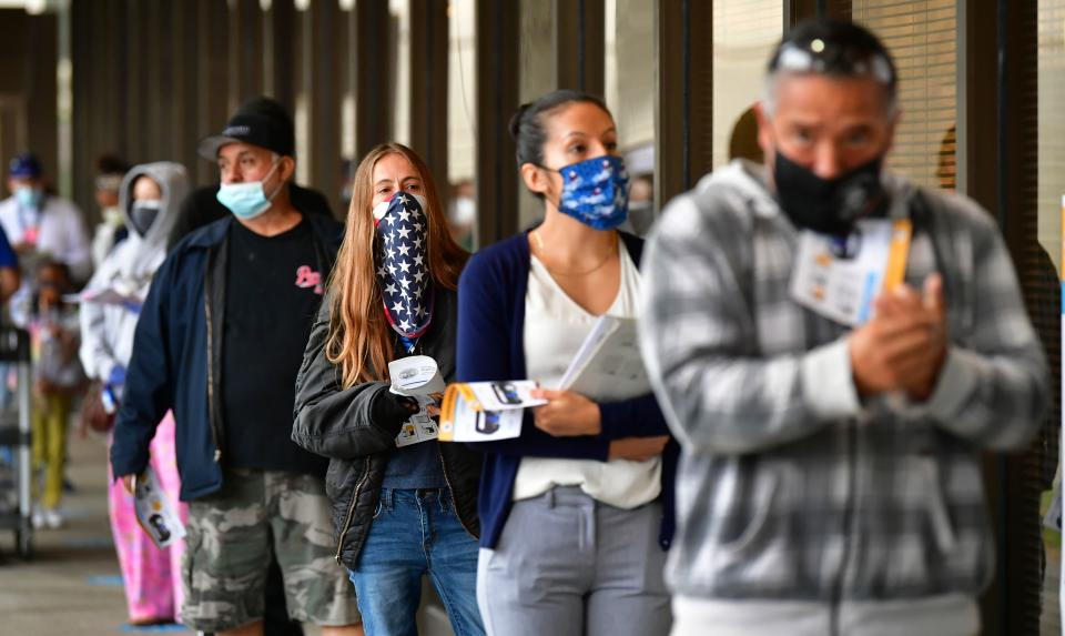 Voters wear face-coverings while waiting in line to vote for the 2020 US elections at the Los Angeles County Registrar in Norwalk, California. Photo: Frederic J Brown/AFP/Getty