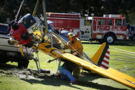 FILE PHOTO: Actor Harrison Ford's damaged airplane is taken away after its crash landing at Penmar Golf Course in Venice, Los Angeles California March 6, 2015. REUTERS/Lucy Nicholso/File PHoto