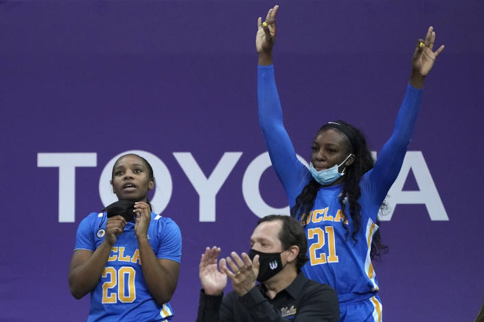 UCLA guard Charisma Osborne (20) and forward Michaela Onyenwere (21) react from the bench during the second half of an NCAA college basketball game against Washington, Sunday, Feb. 7, 2021, in Seattle. (AP Photo/Ted S. Warren)