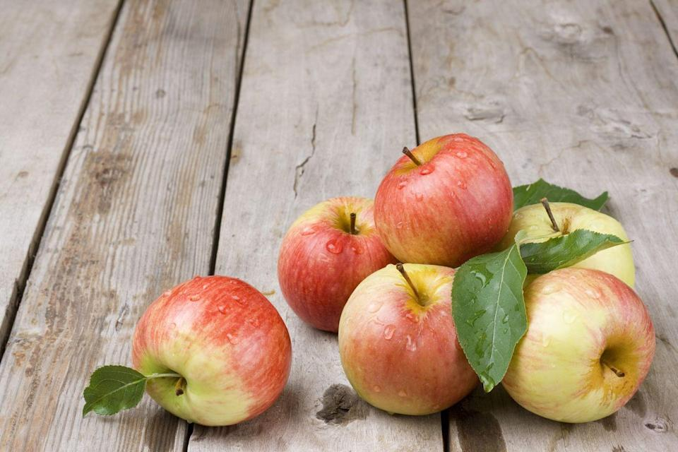 "<p>When you have a craving for something sweet, reach for an apple. ""One large apple has 5 grams of fiber and 14% of your daily vitamin C—important for your immunity and for keeping weight off,"" writes <a href=""https://www.doctoroz.com/"" rel=""nofollow noopener"" target=""_blank"" data-ylk=""slk:Mehmet Oz"" class=""link rapid-noclick-resp"">Mehmet Oz</a>, M.D., in his book <a href=""https://www.amazon.com/Food-Can-Fix-Superfood-Healthy/dp/1501158163/?tag=syn-yahoo-20&ascsubtag=%5Bartid%7C10050.g.35715141%5Bsrc%7Cyahoo-us"" rel=""nofollow noopener"" target=""_blank"" data-ylk=""slk:Food Can Fix It"" class=""link rapid-noclick-resp""><em>Food Can Fix It</em></a>. To start your day right, try this quick and easy <a href=""https://www.prevention.com/food-nutrition/recipes/a20522990/apple-cinnamon-yogurt/"" rel=""nofollow noopener"" target=""_blank"" data-ylk=""slk:Apple-Cinnamon Yogurt"" class=""link rapid-noclick-resp"">Apple-Cinnamon Yogurt</a> recipe.</p>"