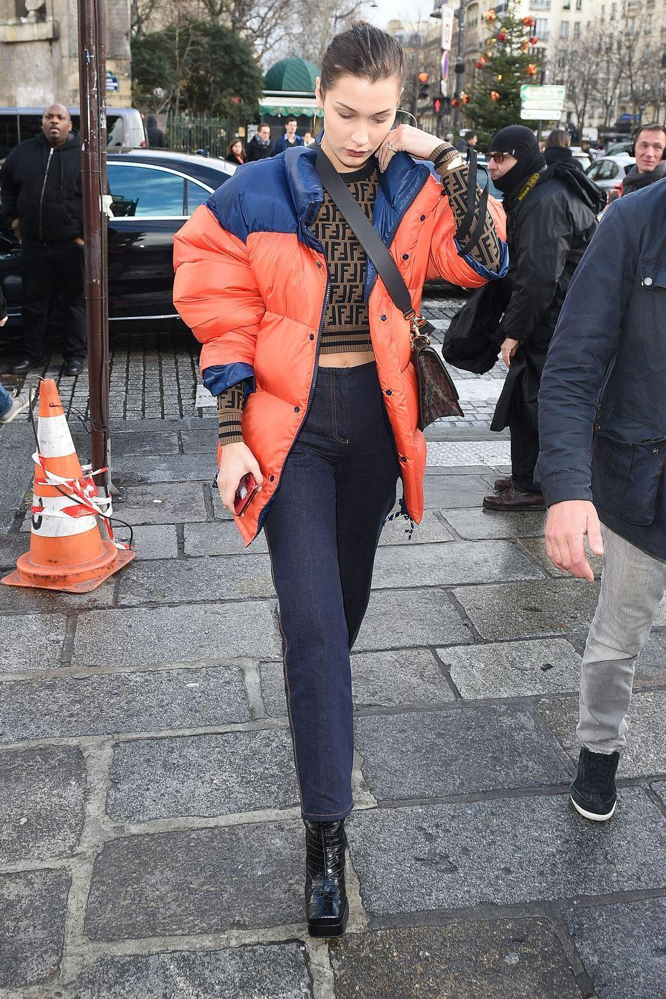 <p>In a colorblock puffer jacket, cropped Fendi sweater and crossbody bag, high-waisted jeans, and square-toe boots while out in Paris.</p>