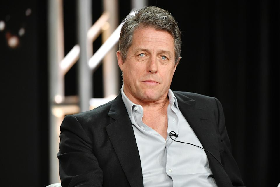 """PASADENA, CALIFORNIA - JANUARY 15: Hugh Grant of """"The Undoing"""" speaks during the HBO segment of the 2020 Winter TCA Press Tour at The Langham Huntington, Pasadena on January 15, 2020 in Pasadena, California. (Photo by Amy Sussman/Getty Images)"""