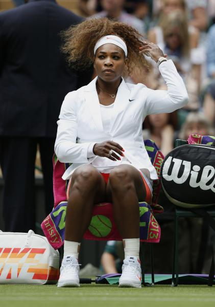 Serena Williams of the United States sits court side ahead of her Women's first round singles match against Mandy Minella of Luxembourg at the All England Lawn Tennis Championships in Wimbledon, London, Tuesday, June 25, 2013. (AP Photo/Sang Tan)