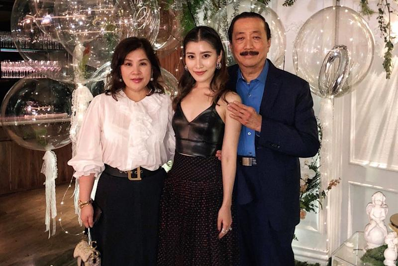 Chryseis Tan (centre) with her mother and father, Tan Sri Vincent Tan (right). ― Pix via Instagram/Chryseis Tan