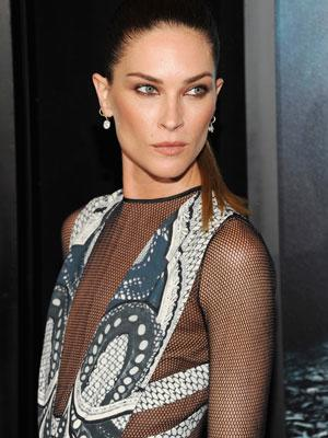 Actress/Model/Muse Erin Wasson wearing a graphic print style plunge with mesh full length sleeves at the 'Abraham Lincoln: Vampire Hunter' premiere, New York City.