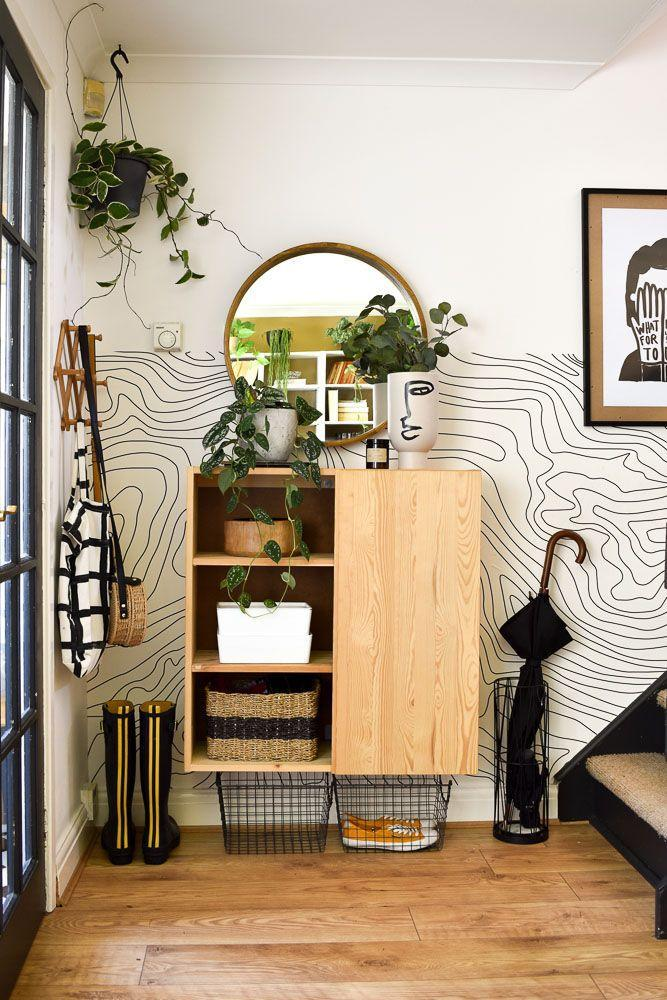 """<p>""""I wanted to create an area that was separate from the living room. I zoned the space with monochrome removable wallpaper from Etsy and added functional storage using an <a href=""""https://go.redirectingat.com?id=127X1599956&url=https%3A%2F%2Fwww.ikea.com%2Fgb%2Fen%2Fp%2Fivar-cabinet-pine-40033763%2F&sref=https%3A%2F%2Fwww.harpersbazaar.com%2Fuk%2Fculture%2Flifestyle_homes%2Fg35595137%2Finside-the-home-of-interiors-blogger-medina-grillo%2F"""" rel=""""nofollow noopener"""" target=""""_blank"""" data-ylk=""""slk:Ikea Ivar cabinet,"""" class=""""link rapid-noclick-resp"""">Ikea Ivar cabinet,</a> and peg hooks for bags and outdoor wear. Removing one door from the cabinet allowed me to have a section to display the prettier items, and at the same time, hide the less prettier (but very useful) items out of sight.""""</p>"""