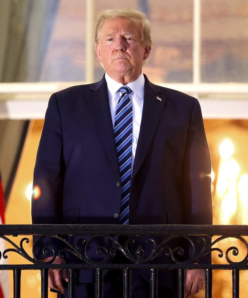 WASHINGTON, DC – OCTOBER 05: U.S. President Donald Trump stands on the Truman Balcony after returning to the White House from Walter Reed National Military Medical Center on October 05, 2020 in Washington, DC. Trump spent three days hospitalized for coronavirus. (Photo by Win McNamee/Getty Images)