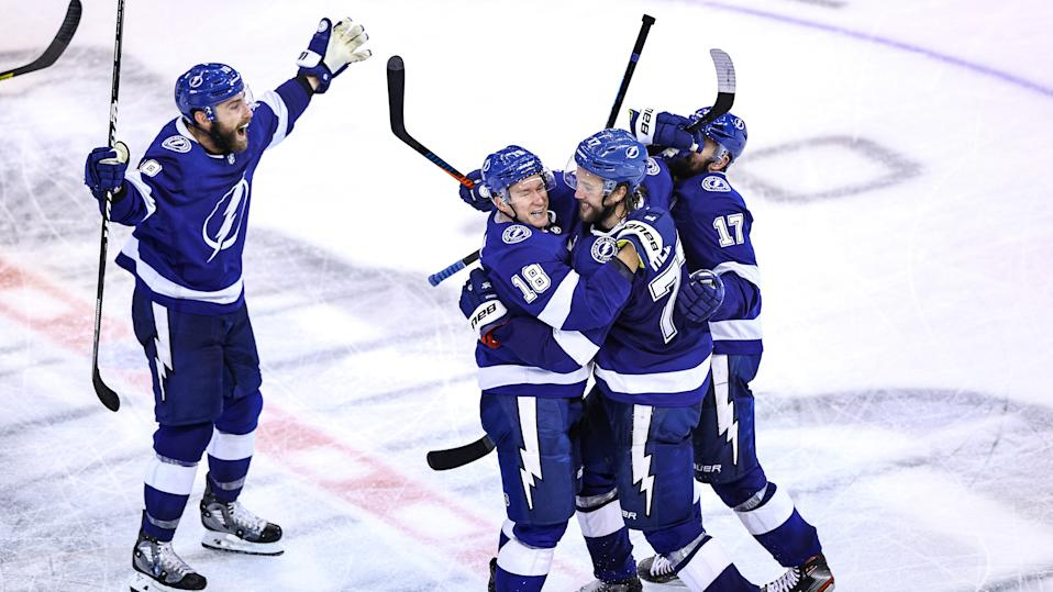 TORONTO, ONTARIO - AUGUST 31:  Victor Hedman #77 of the Tampa Bay Lightning is congratulated by his teammates, Ondrej Palat, Alex Killorn, and Barclay Goodrow after scoring the game-winning goal during the second overtime period to give his team the 3-2 victory against the Boston Bruins in Game Five of the Eastern Conference Second Round during the 2020 NHL Stanley Cup Playoffs at Scotiabank Arena on August 31, 2020 in Toronto, Ontario. (Photo by Elsa/Getty Images)