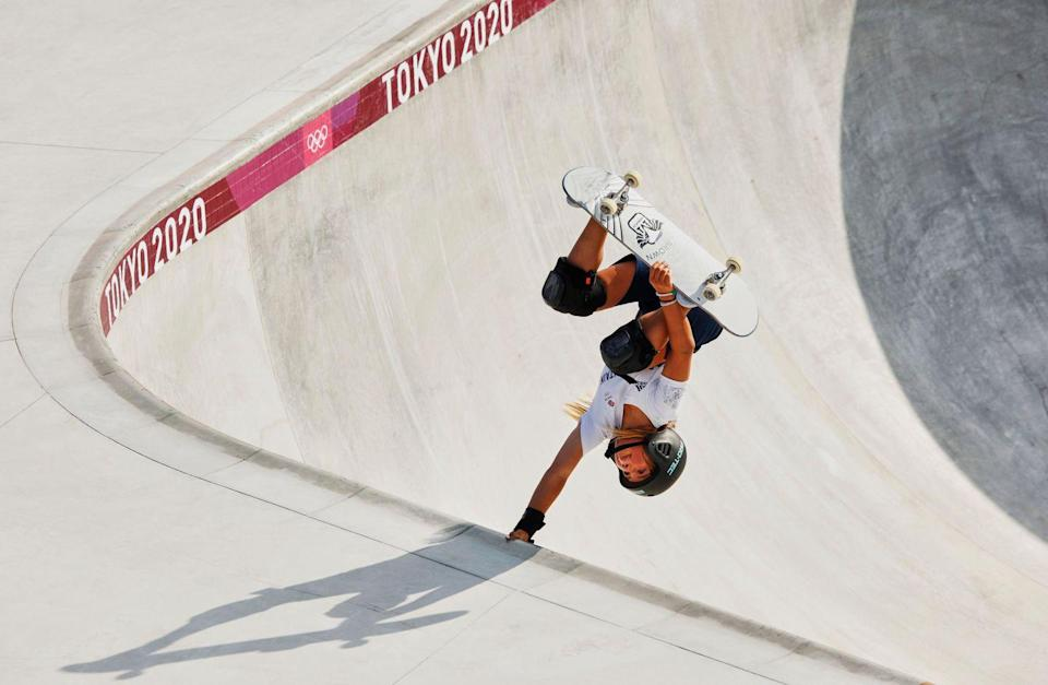 <p>England's Sky Brown gets inverted during training ahead of her olympic competition.</p>