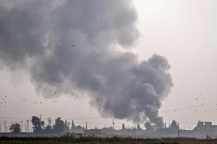 Smoke rises from the Syrian town of Tal Abyad after Turkish bombings, in a picture taken from the Turkish side of the border near Akcakale in the Sanliurfa province on Oct. 9, 2019. (Photo: Bulent Kilic/AFP via Getty Images)
