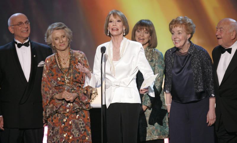 "FILE - In this Jan. 2007 file photo, the cast of ""The Mary Tyler Moore Show,"" from left, Gavin MacLeod, Cloris Leachman, Mary Tyler Moore, Valerie Harper, Georgia Engel and Ed Asner, present the award for outstanding performance by an ensemble in a comedy series at the 13th Annual Screen Actors Guild Awards, in Los Angeles. The 82-year-old MacLeod's autobiography, ""This is Your Captain Speaking,"" will be released Tuesday, Oct. 22, 2013. (AP Photo/Mark J. Terrill, File)"
