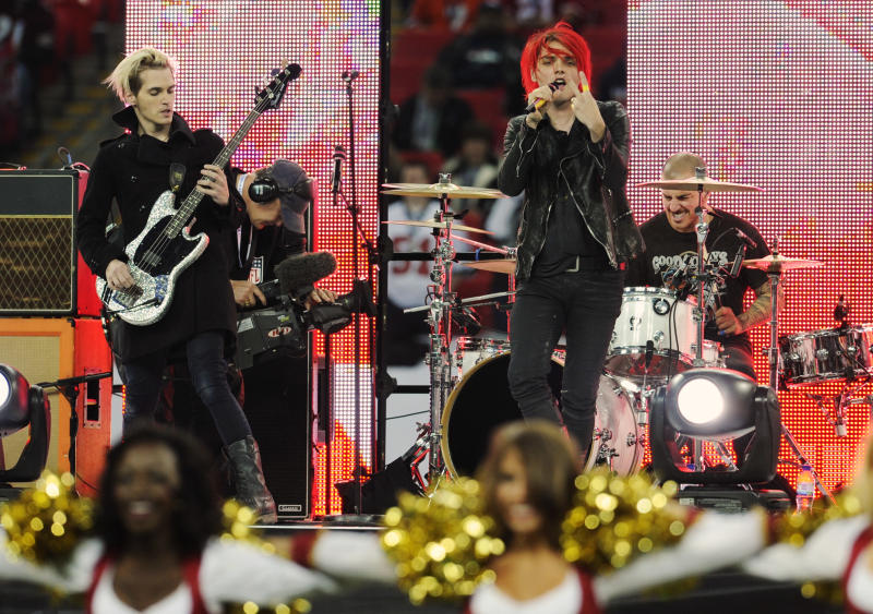 "FILE - In this Oct. 31, 2010 file photo, My Chemical Romance performs during the pre-game show for the NFL Football game between the Denver Broncos and San Francisco 49ers at Wembley Stadium in London.  The New Jersey-based band announced early Saturday, March 23, 2013,  that ""it has come time for it to end."" The foursome thanked their fans in a statement and said the experience was ""a true blessing."" My Chemical Romance's sound is a mix of alternative, punk rock and pop. They released their debut album in 2002, but really made a splash on the music scene in 2004 with the platinum-selling ""Three Cheers for Sweet Revenge."" It featured the Top 40 hit ""Helena."" (AP Photo/Tom Hevezi)"