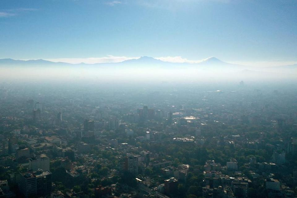 MEXICO-ENVIRONMENT-POLLUTIONAerial view showing low visibility due to air pollution in Mexico City, on January 1, 2021, during the COVID-19 coronavirus pandemic. (Photo by ALFREDO ESTRELLA / AFP) (Photo by ALFREDO ESTRELLA/AFP via Getty Images)